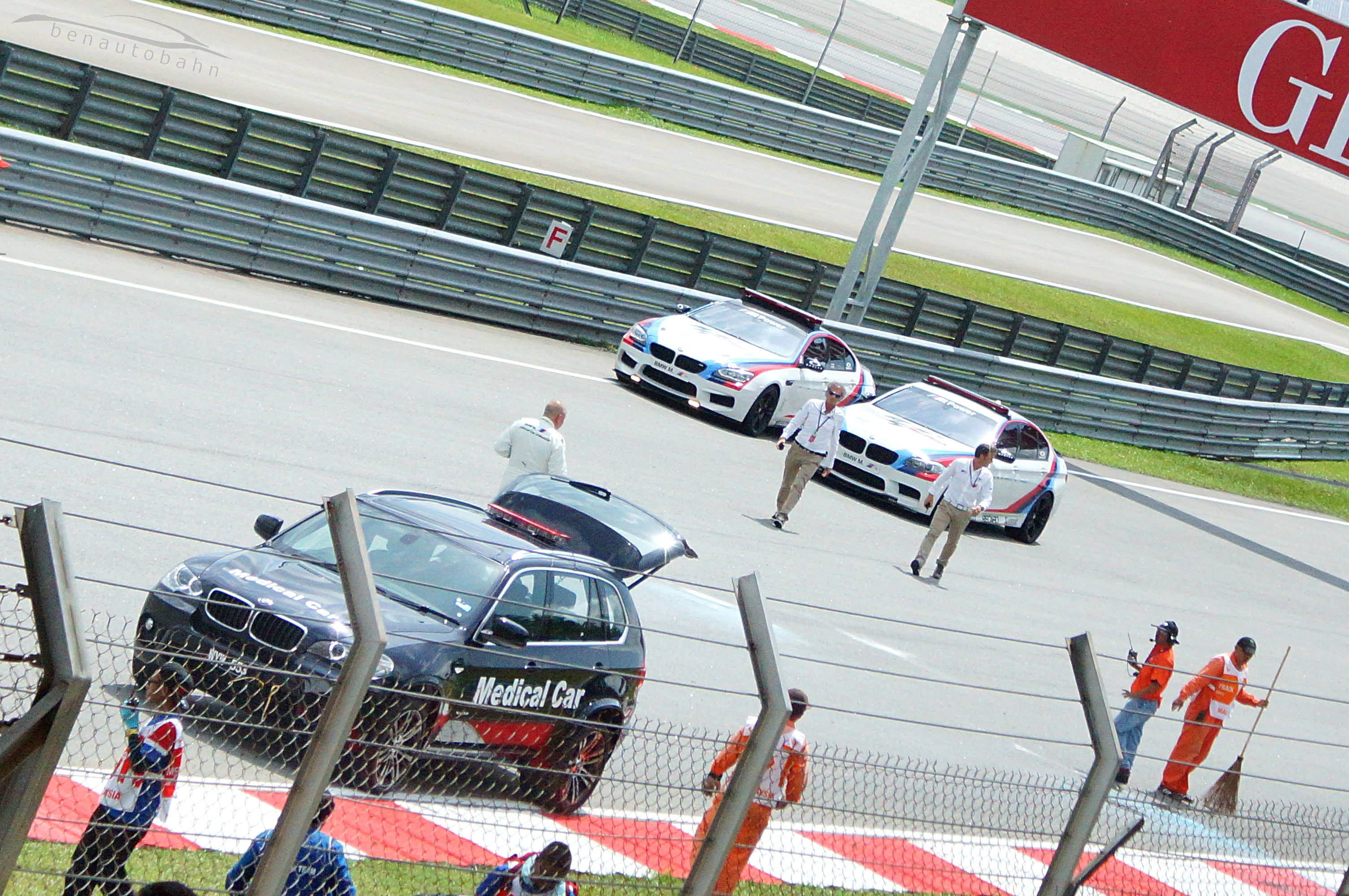 Loris Capirossi (right) and his partner (left) from the M5 Safety Car walking towards the crash site