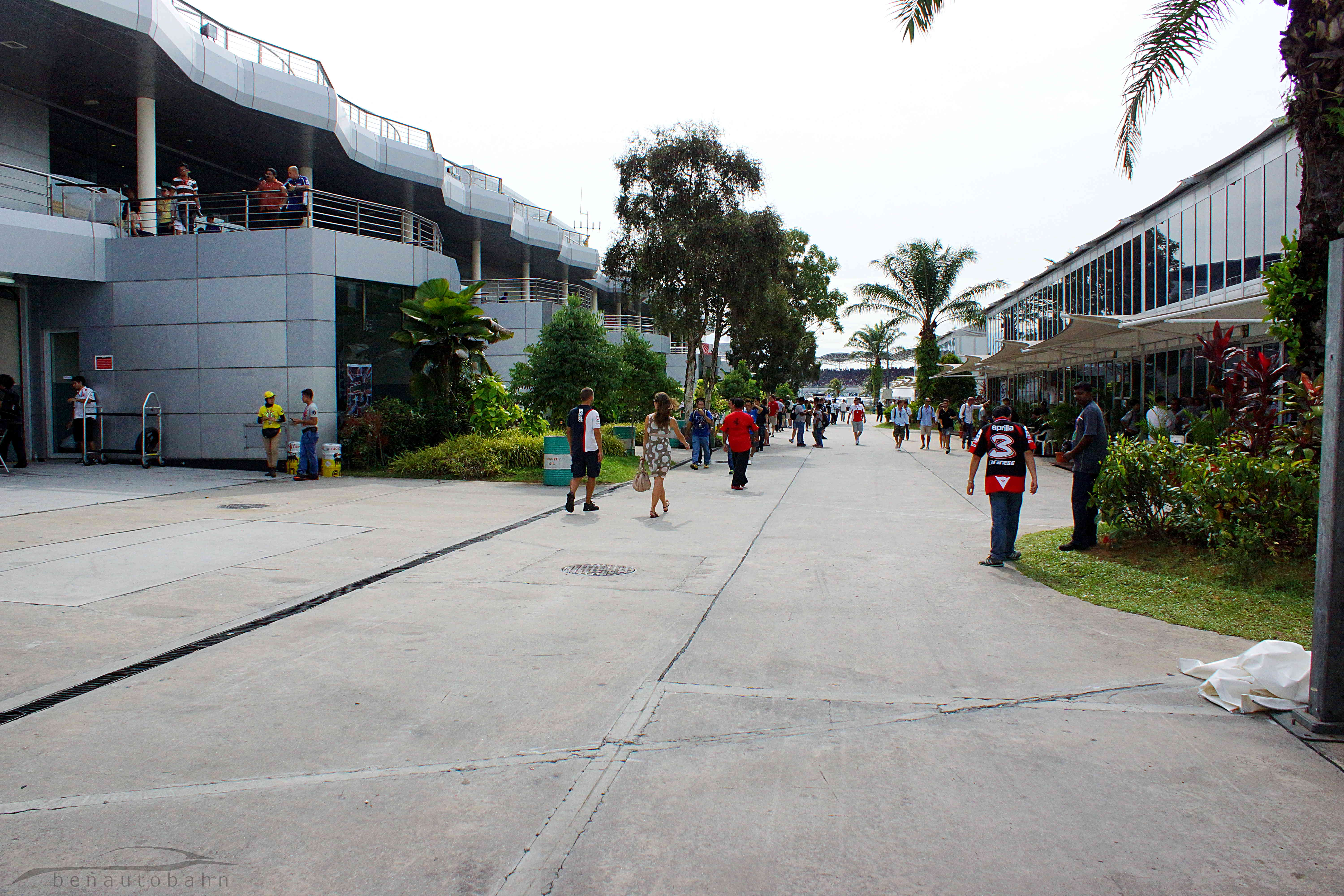 Pit garages on the left, and hospitality areas on the right.