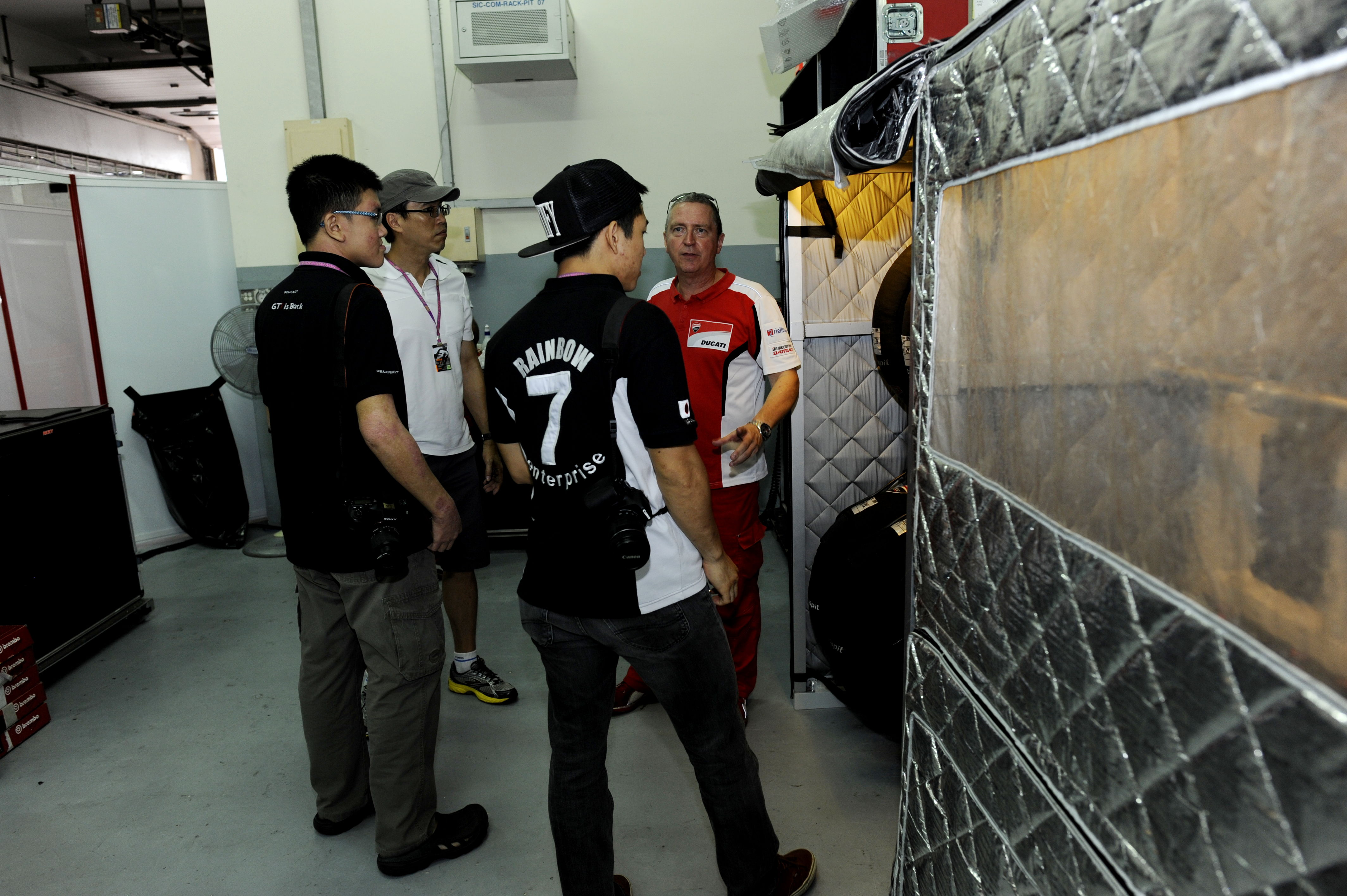 Being shown where Ducati preheats their tires for maximum performance when it hits the track